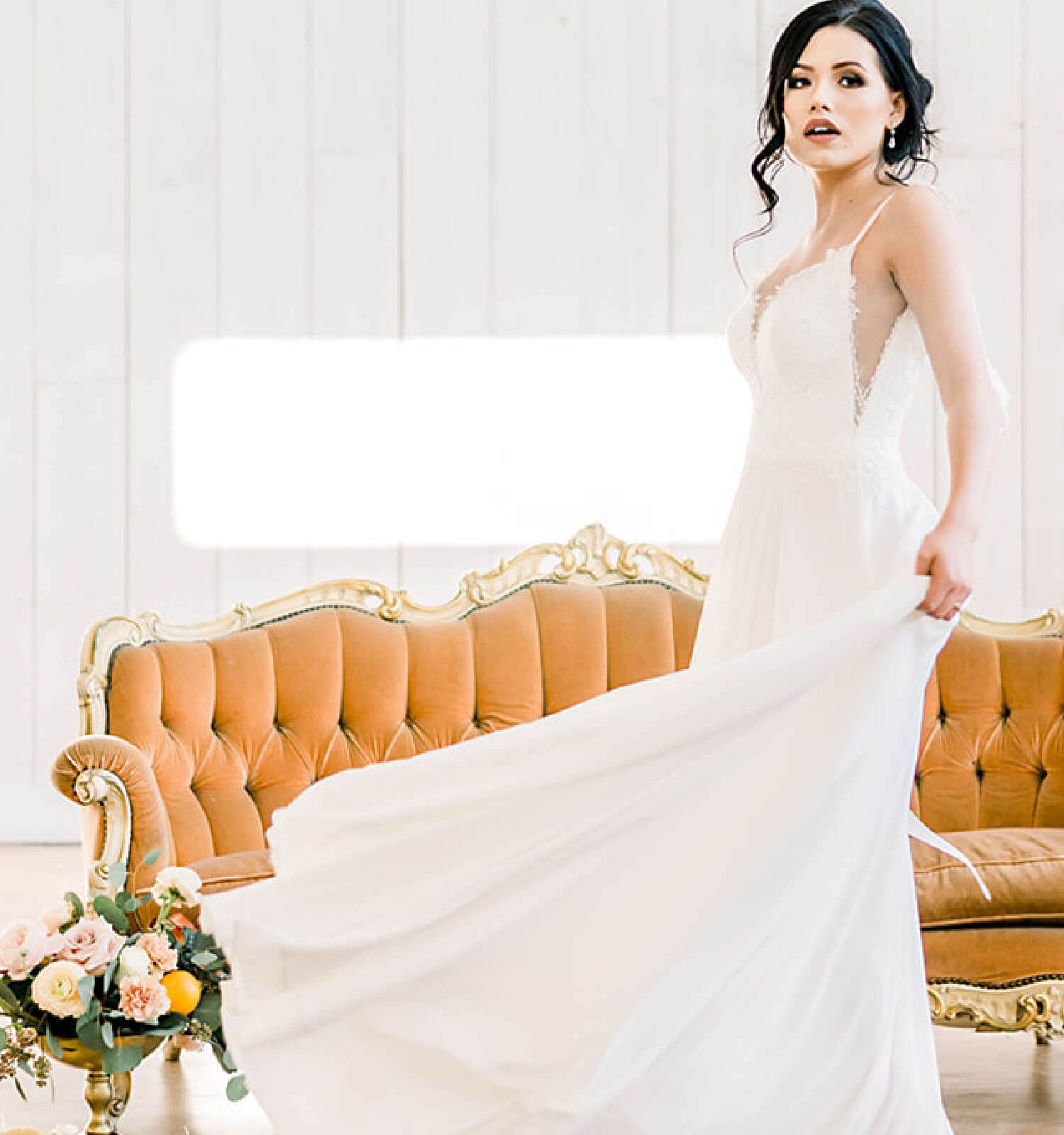 Model wearing a white bridal gown