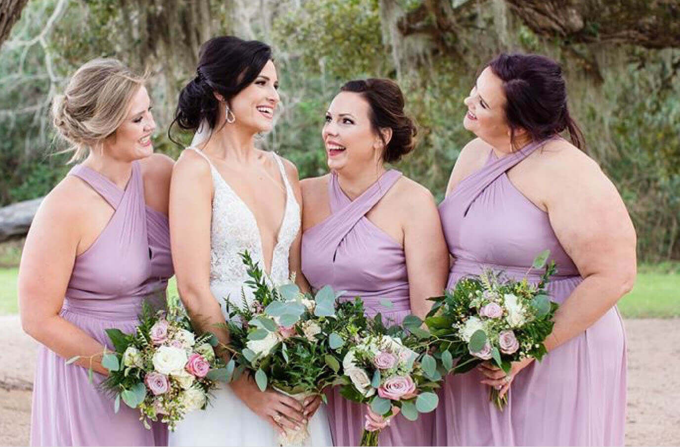 Photo of the bride and bridesmaids wearing purple dresses