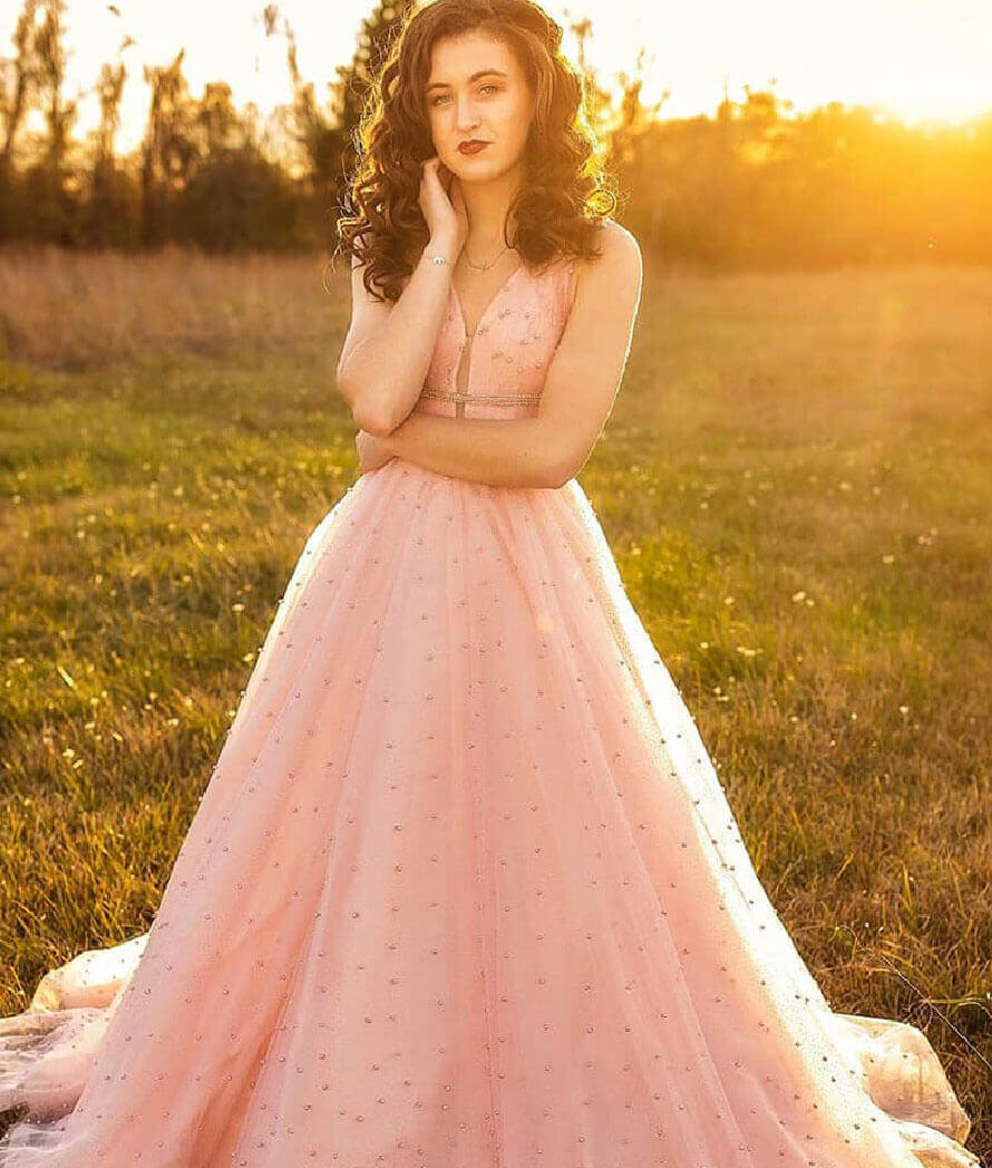 Model wearing a pink prom collection gown